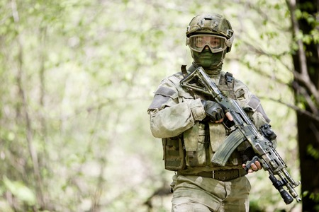 Soldier in camouflage and helmet Stock Photo