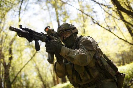 Officer aims keeping machine gun