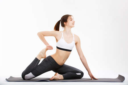 mental activity: Young woman exercise yoga supported headstand