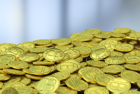 Golden bitcoins on gray background
