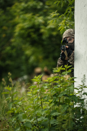 Airsoft players with assault rifles