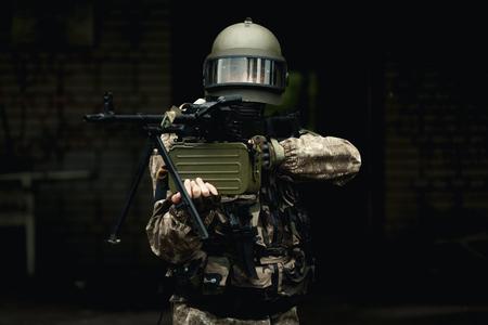 Military man in camouflage , helmet