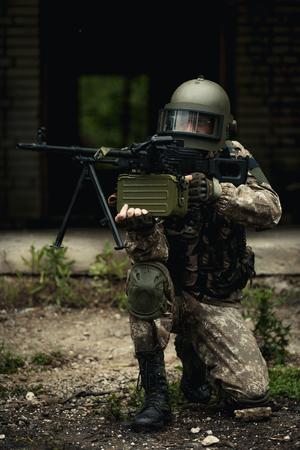 Striped player with submachine gun