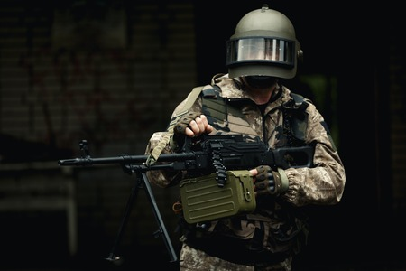 Soldier in camouflage on street Stock Photo