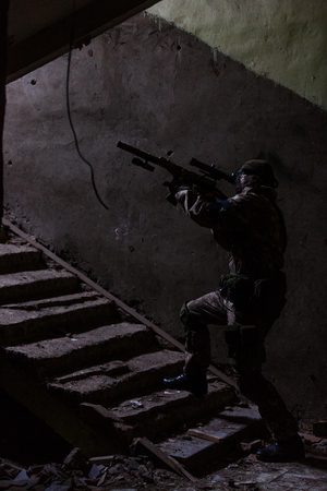 One military man on stairs