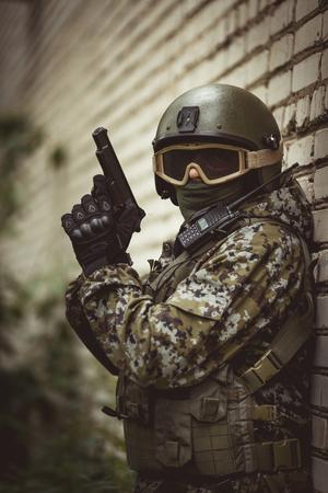 Military man near brick building