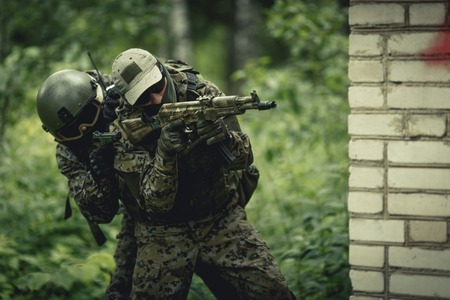 Photo of military in camouflage