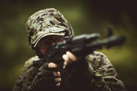 Photo of soldier with submachine-gun Stock Photo