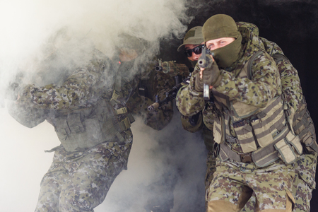 Photo of soldiers amid smoke Stock Photo