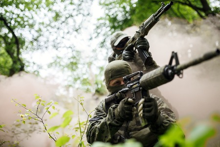 Soldiers on exercises in forest