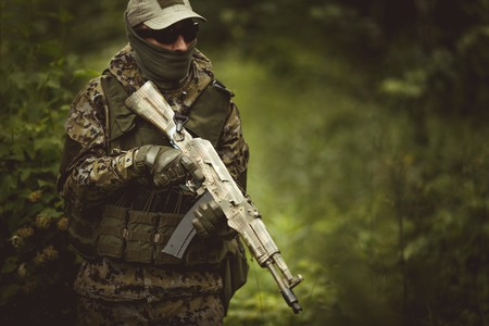 Soldier in camouflage wearing helmet