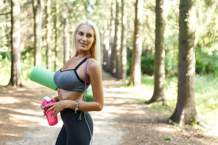 Image of girl in sportswear with rug Stock Photo