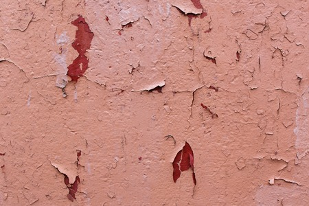 Photo of an old cracked brown paint