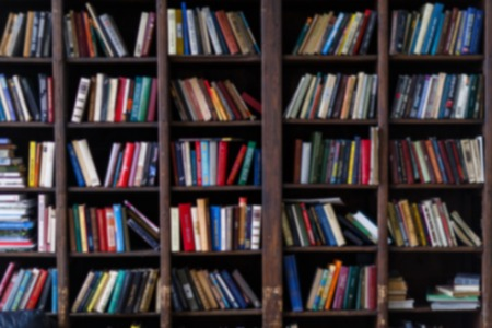 Blurred photo of colorful books in shelves Stock Photo