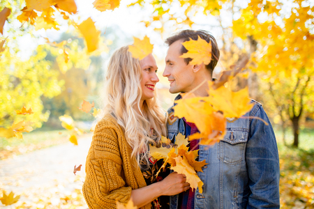 Photo of happy couple in love at autumn forest