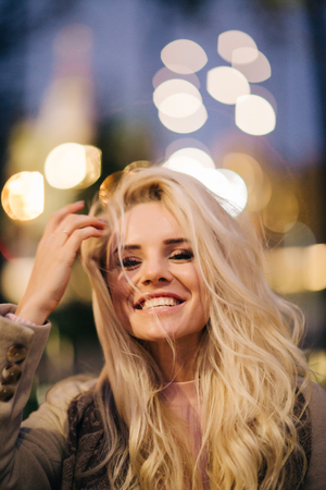 Portrait of blonde on background of evening city