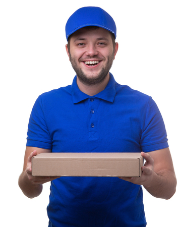 Photo of happy man in blue T-shirt and baseball cap with cardboard box for pizza Stock Photo