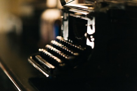 Old typewriter on blurred background Stockfoto