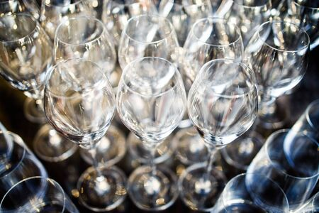 Large number of glass glasses on buffet table