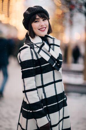 Photo of young brunette on walk on street Banco de Imagens