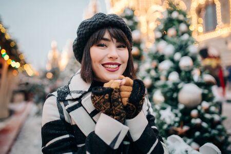 Portrait of happy woman on walk on street