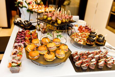Canapes, snacks, sandwiches on table Banco de Imagens - 135017943