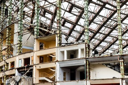 Tall dilapidated building with iron floors Banco de Imagens - 135017948