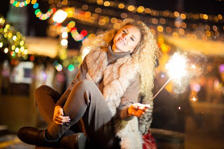 Picture of woman with Bengal lights on winter walk .