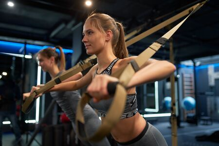 Two athletic women in training with elastic bands Banco de Imagens