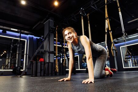 Athletic brunette stretching with elastic bands in gym Banco de Imagens - 136798541