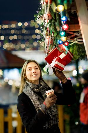 Photo of girl with glass in hands near boxes with gifts Banco de Imagens - 136797677