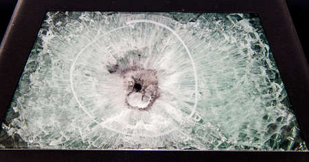 broken glass. Car glass cracked from an accident. Armored glass after impact. glass reinforced with a film after being hit by a bullet.