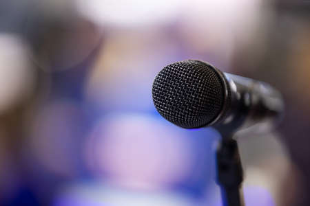 microphone over stage light background. with copyspace Stock Photo