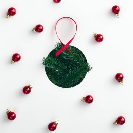 Christmas minimal concept - shape of christmas bauble made from tree branch. Merry christmas (xmas) background. Flat lay new year minimal. Abstract creative pattern. Fashion xmas. Stock fotó