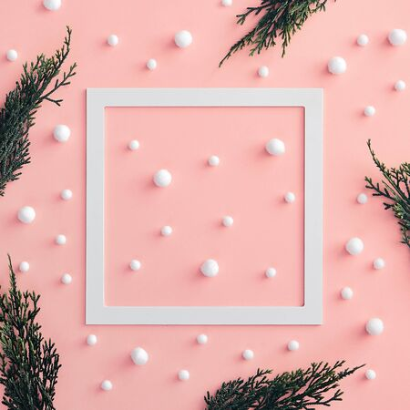 Christmas minimal concept - composition with christmas tree branch and snowball on pink background. White paper frame. Christmas snow winter background. Christmas holiday pattern. Reklamní fotografie