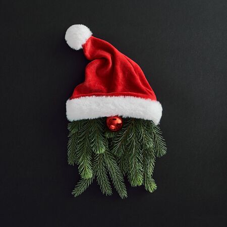 Christmas minimal concept - santa claus creative minimal on dark background. Modern concept christmas santa claus on black, great design for any purposes. Winter holiday background. Seasonal holiday.