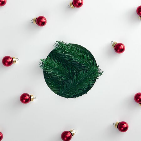 Christmas minimal concept - shape of christmas bauble made from tree branch. Merry christmas (xmas) background. Flat lay new year minimal. Abstract creative pattern. Fashion xmas.