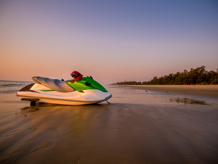 A jet ski at sea shore around sunset