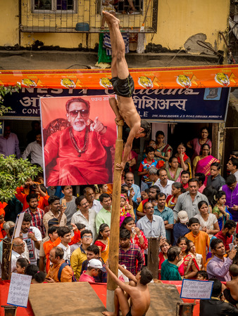 Mumbai, India - March 18, 2018: Unidentified kids perform Malkhamb, a traditional Indian sport, perform on a wooden pole,on occasion of Hindu new year, Gudi Padva.