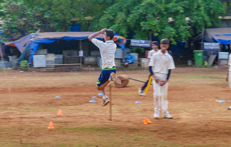 Mumbai, India - April 21, 2018: Unidentified boy practicing fast bowling to improve cricketing skills at Mumbai ground Editorial