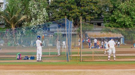 Mumbai, India - April 21, 2018: Unidentified boys practicing batting to improve cricketing skills at Mumbai grounds Editorial