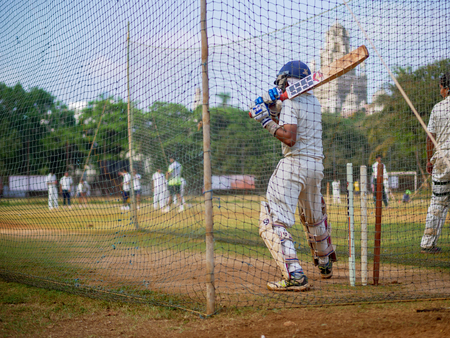 Mumbai, India - April 21, 2018: Unidentified boy practicing batting to improve cricketing skills at Mumbai ground Editorial