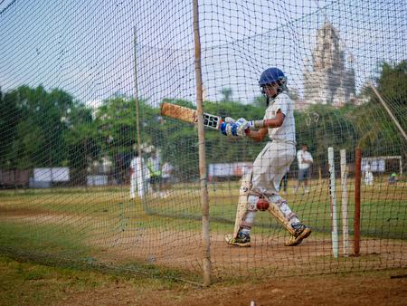 Mumbai, India - April 21, 2018: Unidentified boy practicing batting to improve cricketing skills at Mumbai ground Sajtókép