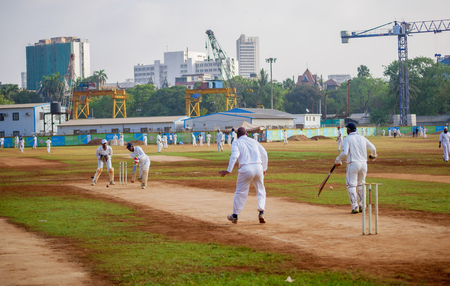Mumbai, India - April 21, 2018: Unidentified men playing cricket at Mumbai ground