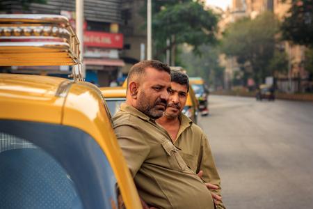 MUMBAI, INDIA - DECEMBER 21, 2014 : Taxi drivers in Mumbai awaiting for Passengers to arrive Editorial