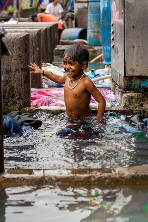 MUMBAI, INDIA - JULY 7, 2016 : Child of India - portrait of India young small girl child ready to take a bath