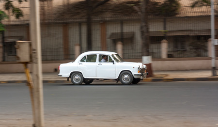 MUMBAI, INDIA - JANUARY 14, 2017 : Vintage Ambassador car running on streets of Mumbai