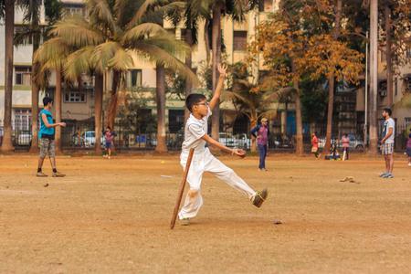 MUMBAI, INDIA - JANUARY 14, 2017 : A kid practicing fast bowling to improve cricketing skills at Mumbai grounds Editorial