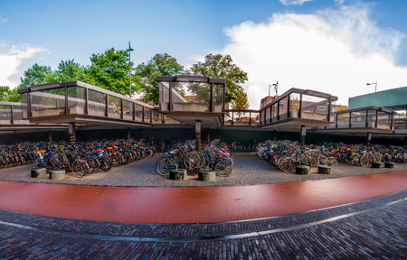 Breda, Netherlands - August 25, 2018 : Huge Bicycles parking outside Brad station in Holland