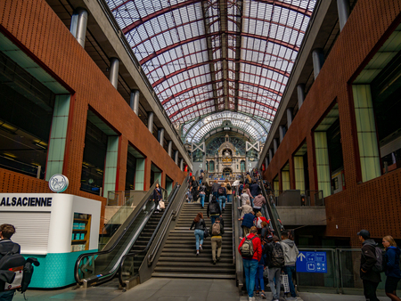 ANTWERP, Belgium - August 25, 2018 : Interior of the Central Train Station of Antwerp with passengers movement